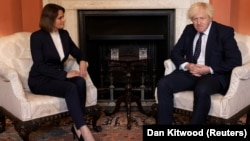 """British Prime Minister Boris Johnson meets with Belarusian opposition leader Svyatlana Tsikhanouskaya at 10 Downing Street in London on August 3. She said Johnson is """"a person who really shares common values with Belarusians."""""""