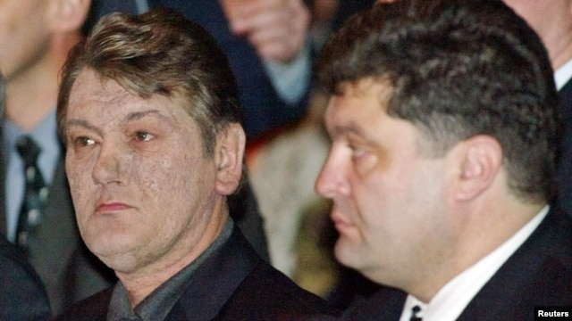President Viktor Yushchenko (left) and the secretary of the National Defense and Security Council, Petro Poroshenko, attend a party convention in Kyiv in March 2005.