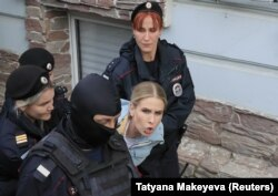 Russian police detain opposition figure Lyubov Sobol near her office in Moscow on August 10.