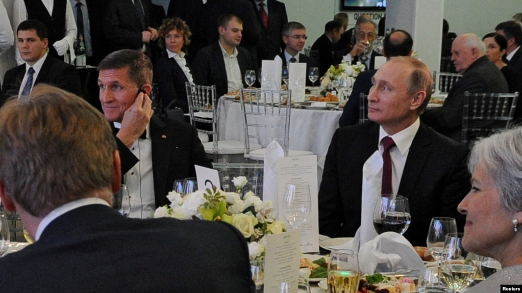 Russian President Vladimir Putin (right) sits next to retired U.S. Army Lieutenant General Michael Flynn at a Russia Today dinner in 2015.