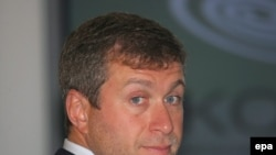 Kremlin-connected oligarch Roman Abramovich laying the cornerstone of the new Skolkovo Business School near Moscow in 2006.