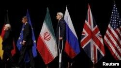 Слева направо: министры иностранных дел Ирана и Великобритании Мохаммад Джавад Зариф и Филип Хаммонд, госсекретарь США Джон Керри