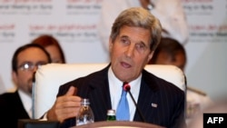 "U.S. Secretary of State John Kerry addresses the ""Friends of Syria"" meeting in the Qatari capital, Doha, on June 22."