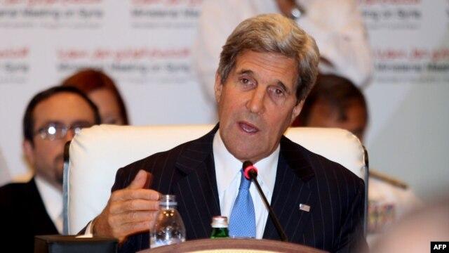 U.S. Secretary of State John Kerry addresses the 'Friends of Syria' meeting in the Qatari capital, Doha, on June 22.