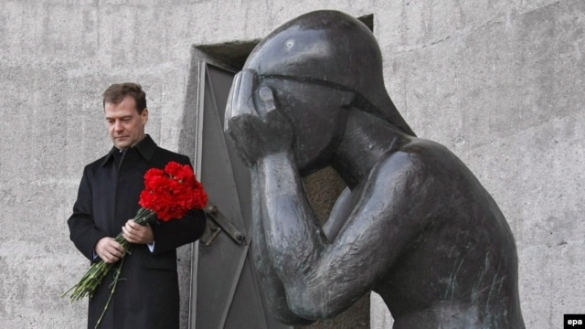 President Dmitry Medvedev lays flowers at a monument honoring victims of Stalin purges