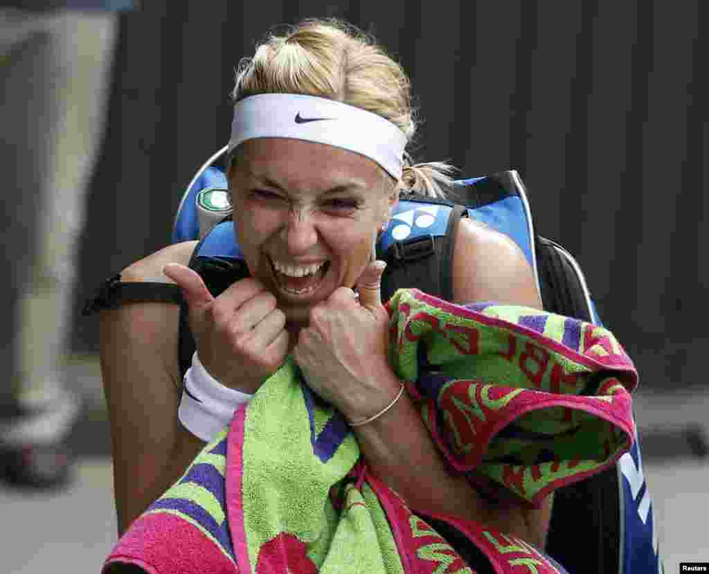 Sabine Lisicki of Germany celebrates after defeating Serena Williams of the United States during their women's singles tennis match at the Wimbledon tennis championships in London. (Reuters/Eddie Keogh)