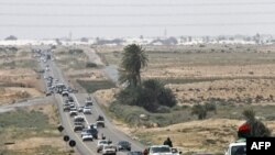 Libya -- Rebels flee from Ras Lanuf to Uqayla, 30Mar2011