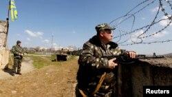 Белбектеги аба базанын кызматкери орус армиясы басып алганга чейин. 21-март, 2014-жыл.