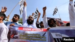 Supporters of the Jamaat-ud-Dawa Islamic organization attend an anti-U.S. protest against a drone strike in Islamabad in May 2016.