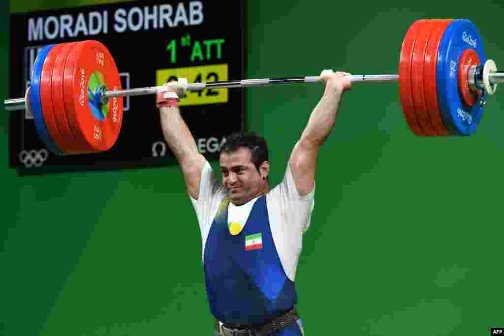 Iran's Sohrab Moradi competes during the men's weightlifting 94-kilogram event.
