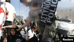 Riot police remove student protesters during an antiausterity demonstration in Athens.
