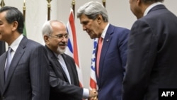 Iranian Foreign Minister Mohammad Javad Zarif (left) shakes hands with U.S. Secretary of State John Kerry following talks in Geneva in early November.
