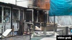 """Сгоревшие торговые ряды на рынке """"Алатау"""". Алматы, 12 декабря 2013 года."""