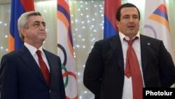 Armenia - President Serzh Sarkisian (L) and Prosperous Armenia Party leader Gagik Tsarukian at an awards ceremony organied by the National Olympic Committee near Yerevan, 26Dec2012.