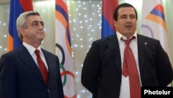 "Armenian President Serzh Sarkisian (left) and opposition leader Gagik Tsarukian (right) Sarkisian and Tsarukian have recently pledged to ""oust"" each other from politics."