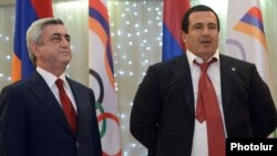 Armenia - President Serzh Sarkisian (L) and Prosperous Armenia Party leader Gagik Tsarukian at an awards ceremony organized by the National Olympic Committee near Yerevan, 26Dec2012.