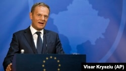 European Council President Donald Tusk speaks at a press conference after a meeting with Kosovo's president in Pristina on April 26.