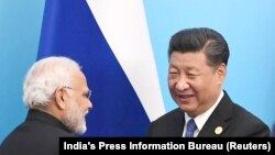Indian Prime Minister Narendra Modi (left) and Chinese President Xi Jinping (file photo)