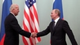 Then-U.S. Vice President Joe Biden (left) shakes hands with then-Russian Prime Minister Vladimir Putin during their meeting in Moscow on March 10, 2011.