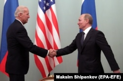 Then-Vice President Joe Biden (left) shakes hands with then-Prime Minister Vladimir Putin during their meeting in Moscow in March 2011.