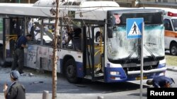 Police survey the scene after an explosion on a bus in Tel Aviv on November 21.