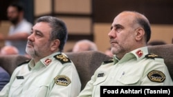Tehran Police commander Hossein Rahimi (R) and head of Iran's Police forces Hossein Ashtari, in a ceremony in Tehran, undated.