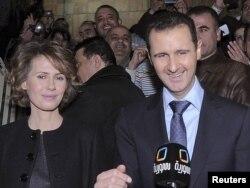 Bashar al-Assad və həyat yoldaşı Asma