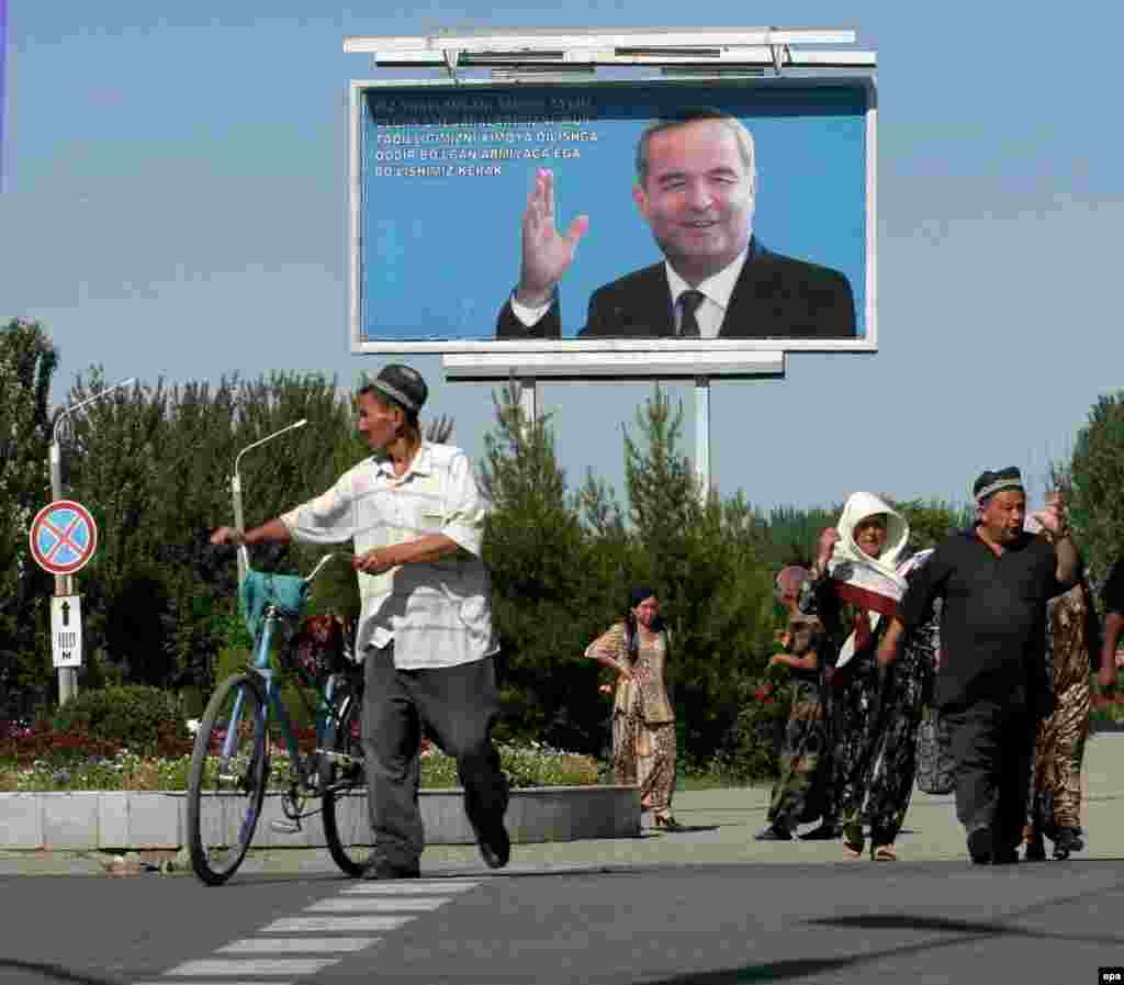 A billboard of President Karimov smiles over a street in Andijon - Uzbek President Islam Karimov has maintained that the unrest in Andijon was organized by international extremist groups with support from Islamists outside the country, and has refused to fulfill demands for an independent probe into the events. No high-ranking government officials have been held responsible for the deadly use of force.