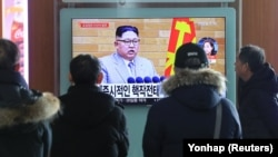 People in Seoul watch a TV broadcasting a news report on North Korean leader Kim Jong Un speaking during a New Year's Day speech on January 1.