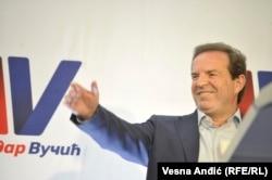 Bogoljub Karic celebrates Aleksandar Vucic's victory in the presidential election at his campaign headquarters in Belgrade in April 2017.