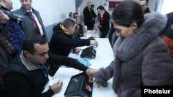Armenia - Election officials test new electronic machines for voter identification at a polling station in Armavir province, 12Feb2017.