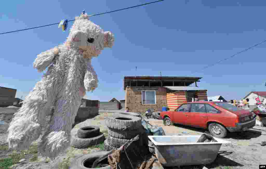 A teddy bear hangs out to dry in Ak-Ordo, on the outskirts of the Kyrgyz capital, Bishkek, on April 11.