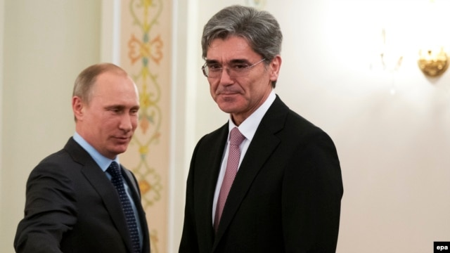 Russian President Vladimir Putin (left) meets with Siemens CEO Joe Kaeser at his Novo-Ogaryovo residence outside Moscow on March 26. Siemens is one of the German firms that will not attend the forum.