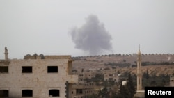 Smoke rises from a base controlled by rebel fighters from the Ahrar al-Sham Movement that was targeted by what activists said were Russian airstrikes in Syria's Idlib Province on October 1.