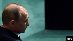 U.S. -- Russian President Vladimir Putin waits to deliver his address during the 70th session of the United Nations General Assembly at UN headquarters in New York, September 28, 2015