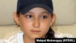 Казахская юная шахматистка Жансая Абдымалик, . Алматы, 27 июня 2012 года.