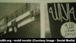 Черный флаг «ИГИЛ», который был вывешен на Юнусабадском мосту в Ташкенте.