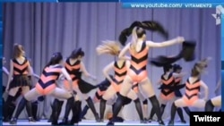 "Local media reports said that the girls performed ""a bees' dance"" wearing orange-and-black striped costumes."