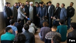 Prosecutor Montazeri facing protesters arrested in November during a visit to a Tehran prison.