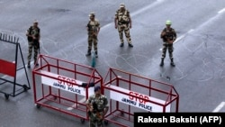 Indian security personnel stand guard at a roadblock in Jammu in Indian-administered Kashmir on August 7.