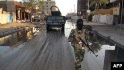 Forcat policore qeveritare duke patrulluar në qytetin Ramadi në Irak
