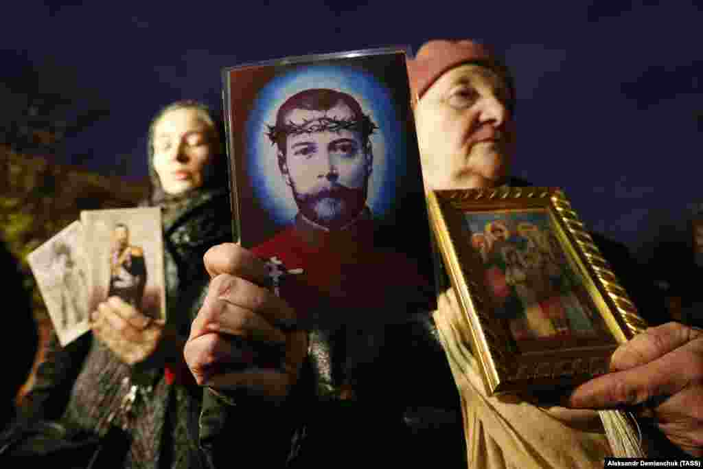 Russian Orthodox believers holding portraits of the last tsar, Nicholas II, protest outside the Mariinsky Theater before the premiere of Russian film director Aleksei Uchitel's movie Matilda in St. Petersburg on October 23. (TASS/Aleksandr Demianchuk)