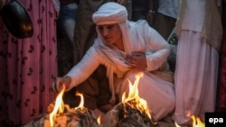 Yazidis gather at the shrine of Sheikh Adi ibn Musafir to celebrate their New Year with the lighting of candles in Lalish, north of Mosul, Iraq, on April 19.