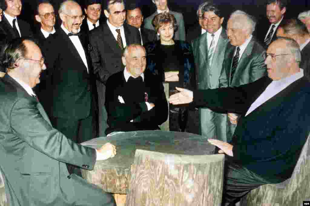 Gorbachev and his foreign minister, Eduard Shevardnadze, meet West German Chancellor Helmut Kohl and Foreign Minister Hans-Dietrich Genscher to discuss the terms of German reunification on July 15, 1990.