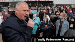 Mikalay Statkevich speaks during a rally in support of opposition politicians seeking to become presidential candidates in Minsk on May 24.