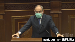 Prime Minister Nikol Pashinian speaks at the National Assembly on May 27