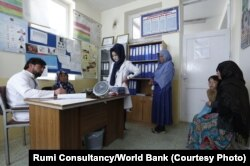 A villager consults a doctor at Bamyan Provincial Hospital.