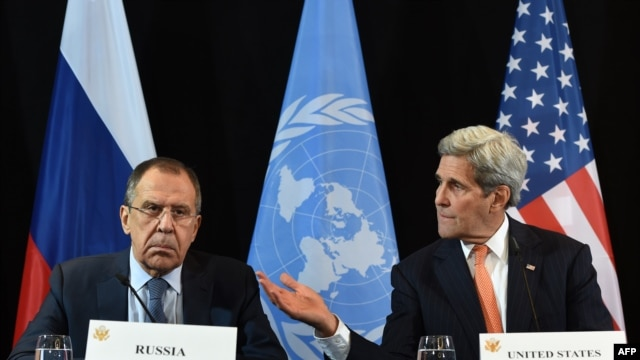 U.S. Secretary of States John Kerry (right) gestures beside of Russian Foreign Minister Sergei Lavrov during a news conference after the International Syria Support Group (ISSG) meeting in Munich on February 12.