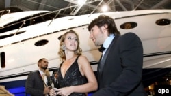 Ksenia Sobchak and TV celebrity Andrei Malakhov take part in the opening ceremony of the Millionaire Fair in Moscow in 2008.