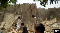Homes destroyed in a drone attack targeting Baitullah Mehsud on August 5